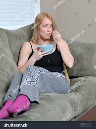 beautiful blonde woman sitting couch stock photo 95551036
