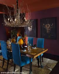 red wall and blue brown dining table design with modern lighting