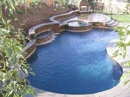 unusual shape backyard pool designs ideas with brick pool edging