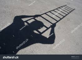 shadow man climbing ladder on asphalt stock photo 55408105