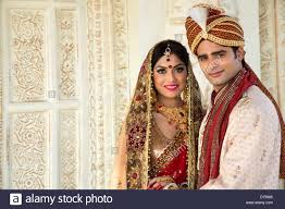 indian wedding dress for groom indian and groom in traditional wedding dress stock photo