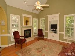 traditional living room with metal fireplace u0026 ceiling fan in wake