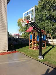 a beautiful blue sky a pro dunk silver basketball goal standing
