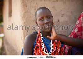 maasai in traditional dress wearing ear ornaments of beaded