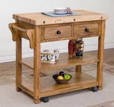 varnished wooden butcher block kitchen island with two drawers and