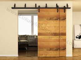 Barn Door Sliding Door by Barn Door Design Company Large Trendy Entry Hall Photo In Orange