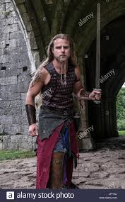 viking warrior hair medieval re enactment viking warrior soldier young man with long