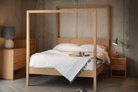 cube modern four poster bed natural bed company