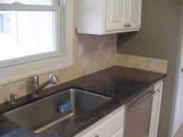 uba tuba granite with white cabinets ubatuba granite countertop with travertine backsplash stocker tile
