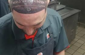 cubs fan gets crazy world series head tattoo