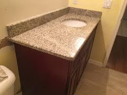 giallo ornamental granite countertops in kitchen with backsplash tiles