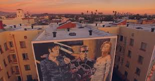 los angeles circa 2015 elvis presley arnold schwarzenegger los angeles circa 2015 elvis presley arnold schwarzenegger marilyn monroe and the beatles murals painted on a building wall in la 4k uhd aerial view