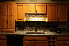 granite countertop cabinets with glass peel and stick backsplash