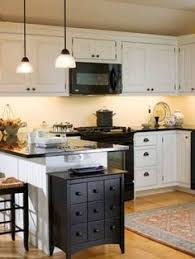 kitchens with white cabinets and black appliances black appliances and white or gray cabinets how to make it work