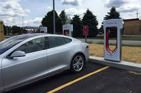 tesla model s charging supercharging a tesla model s at a grocery store