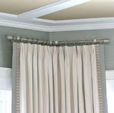 hanging curtains on angled windows window wall corner and window