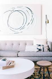 minimalist living room design with grey sofa and white round