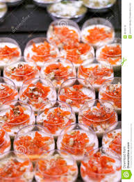 display of small glass verrines with cream and smoked salmon stock