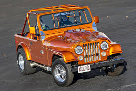 orange jeep this 8 second drag jeep follows the road less traveled rod