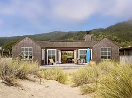 exterior charming beach house designs ideas rectangle shape exterior fantastic beach house designs ideas brown wall paint color concrete floor wheeled chaise lounge outdoor