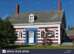 old salt box style house in rural maine painted in red white and
