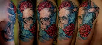 colorful skull with scarlet roses and a bird skull