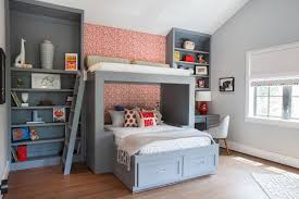 unique bunk beds with tall wall mounted bookshelves on pink wallpaper jpg