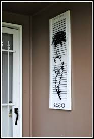 Spray Paint Vinyl Shutters - painted and stenciled shutter with house number decorating ideas