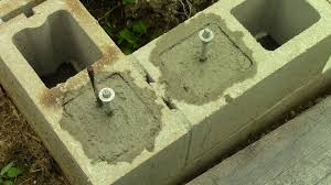 Building A Concrete Block House Filling Concrete Block Cores And Installing J Bolts Youtube