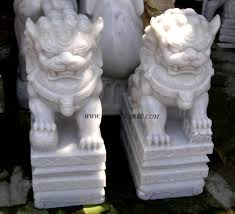 fu dogs marble sculpture foo temple garden carvings