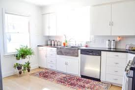 bright and airy bohemian style kitchen sodasippinsister rug similar gold shelf similar canisters round natural tray on top open shelf copper nesting bowls 16 spoon holder next to stove soap