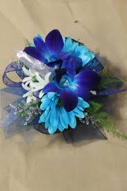 blue corsages for prom blue dendro orchids blue daisies white hyacinths wrist corsage