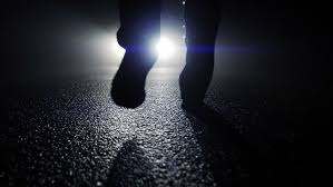 light for walking at night camera following walking feet into light beams at night mystery