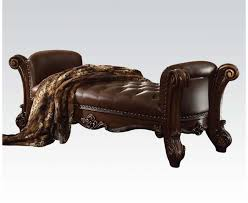 button tufted faux leather bench in brown with carved wood