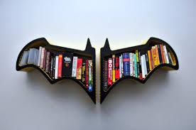 creative bookcase shaped like a bat livinator
