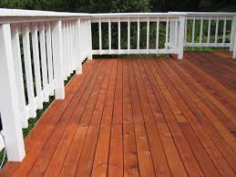 4 important steps to stain a deck that is made with new boards