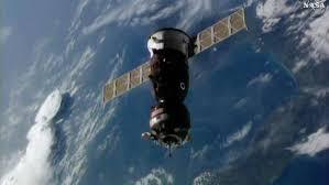 soyuz docks bringing three crew to station space station