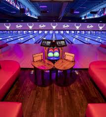black light bowling near me bowling alley lounge area in los angeles bowlero