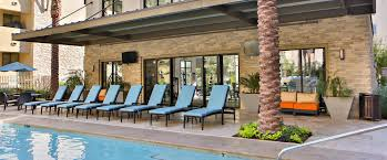 biltmore at camelback apartments in phoenix az raised pool patio with lounge area at biltmore at camelback phoenix az 85016