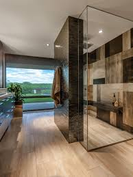 stunning bathroom with a large walk in shower surrounded by black