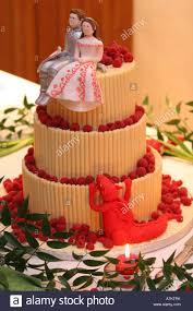 novelty wedding cakes closeup detail of a modern wedding cake with three white chocolate