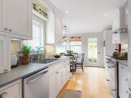 kitchen row galley kitchen design with white cabinets and wooden