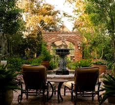 style courtyards brick small space potted plants orleans inspired