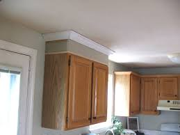 how to make cabinets go to ceiling cabinets taller dio home improvements
