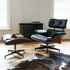 Leather And Wood Chair With Ottoman Design Ideas Eames Inspired Leather Lounge Chair Phone On The Chair Wooden