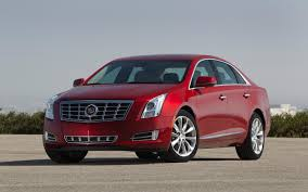 lincoln mks vs cadillac xts we hear dodge dart lincoln mks cadillac xts chevrolet spark