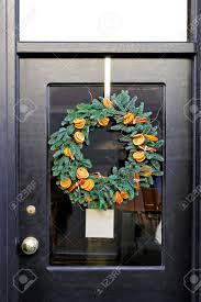 wreath decoration with dry oranges and evergreen branches hanging