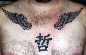 kanji symbol and wings tattoos on chest