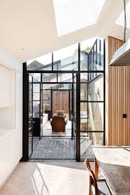 the courtyard house leibal the house s interior spaces will give onto the new courtyards through steel and glass crittal style doors western red cedar clads one of the courtyard