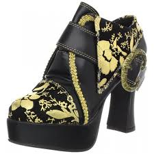 renaissance halloween costumes gold print black platform shoes with buckle detail worn by whoopi